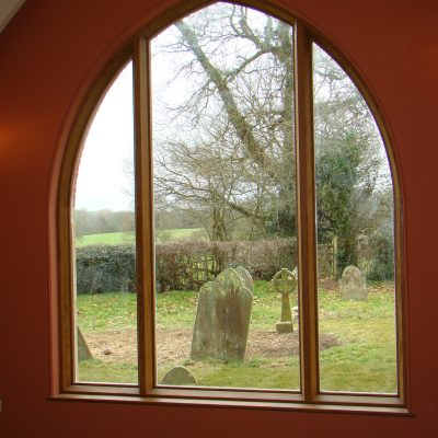 Bespoke wooden church window by Milland Joinery
