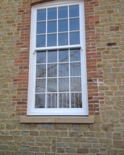 Bespoke wooden window by Milland Joinery