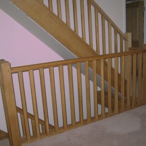 Bespoke wooden hand rails by Milland Joinery